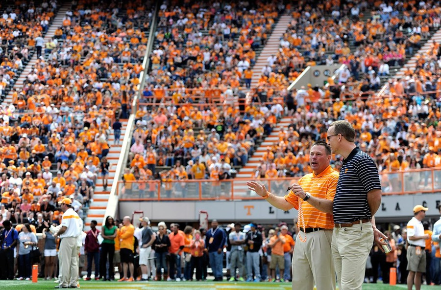 Tennessee head coach Butch Jones and quarterback Peyton Manning, from left, confer on the field before the Orange & White game at Neyland Stadium on Saturday, April 25, 2015 in Knoxville, Tenn. (ADAM LAU/NEWS SENTINEL)